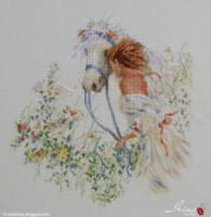 """Вышивка крестом  """"Девушка с лошадью """".  Фото готового полотна вышивки.  Готовое полотно картины вышитой крестом."""